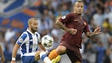 Roma's Radja Nainggolan (right) vies for possession with André André of Porto during the first leg