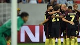 Manchester City celebrate one of their five goals in the Romanian capital