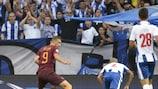Roma's Edin Džeko tries to round Porto keeper Iker Casillas during the first leg