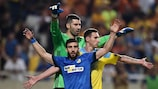 APOEL's George Efrem vies for space with Astana goalkeeper Nenad Erić and Dmitri Shomko