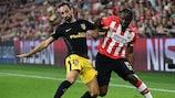 Atlético defender Juanfran (left) tackles PSV's Jetro Willems on matchday one