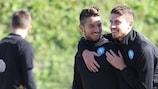 Napoli's Dries Mertens and Jorginho share a joke in training