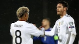 Two-goal Jonas Hector (right) celebrates with hat-trick scorer Serge Gnabry