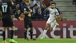 Dani Alves raises an arm in celebration after doubling Juventus's lead