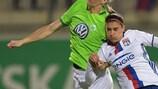 Nilla Fischer of Wolfsburg challenges Lyon's Alex Morgan in the first leg