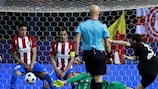Atlético goalkeeper Jan Oblak in the midst of his remarkable triple save