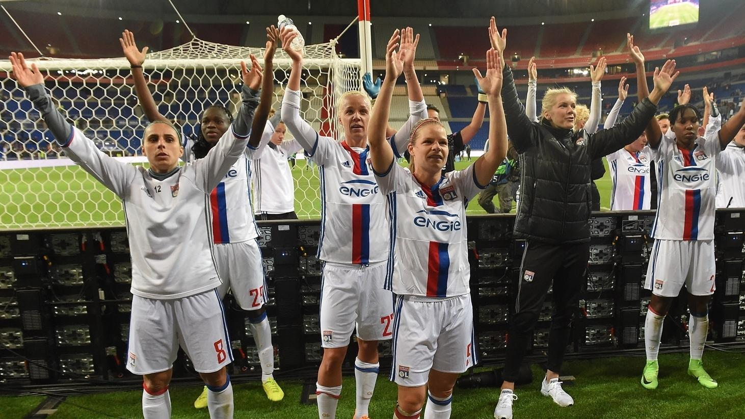 lyon lose on the night but squeeze past