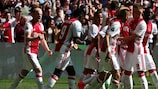 Lasse Schöne is mobbed by team-mates after scoring for Ajax against Feyenoord