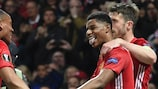Marcus Rashford (centre) celebrates with Anthony Martial and Michael Carrick after scoring for Manchester United