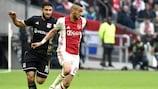 Lyon's Nabil Fekir chases Ajax's Hakim Ziyech