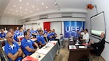 Malta FA president Norman Darmanin Demajo (centre) speaks to the Pro licence students, watched by UEFA Jira Panel member Dany Ryser (right)