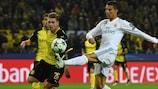 Dortmund's Łukasz Piszczek (left) tackles Cristiano Ronaldo on matchday two