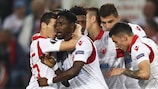 Richmond Boakye (No14) is mobbed after scoring Crvena zvezda's winner at Köln