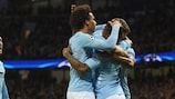 Raheem Sterling (right) celebrates opening the scoring for City