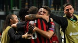 Gonzalo Higuaín gets a hug after scoring for Milan