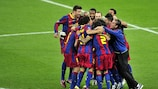 Barcelona players celebrate at the final whistle