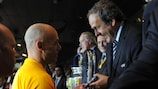 UEFA President Michel Platini congratulates Howard Webb after the 2009/10 UEFA Champions League final