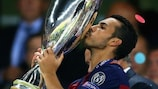 Pedro Rodríguez kisses the trophy; was the winner his last goal for Barcelona?