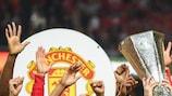 United celebrate completing a set of major UEFA trophies