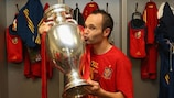 Andrés Iniesta poses in the dressing room with the Henri Delaunay Cup