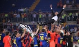 Josep Guardiola is thrown into the air by his Barcelona players
