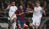 Lionel Messi (centre) tries to get between Liverpool's Álvaro Arbeloa (left) and Dirk Kuyt in the 2007 round of 16