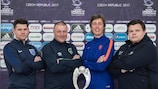 The Group B coaches pose in front of the trophy at the pre-tournament press conference