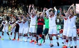 Germany celebrate their 5-3 win on debut against England