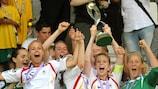 Germany captain Johanna Elsig lifts the trophy