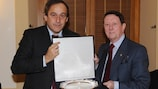 UEFA president Michel Platini receives an award from EPFL chairman Sir Dave Richards