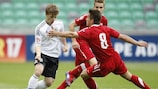 Sebastian Rudol of Poland tries to get to grips with Germany schemer Max Meyer
