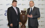 UEFA EURO 2012 operations director Martin Kallen and E. Wedel managing director Paweł Szcześniak stand either side of a chocolate replica of the UEFA European Championship trophy