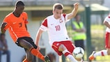 Poland's Adrian Cierpka is shadowed by Netherlands defender Riechedly Bazoer
