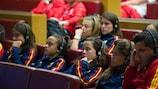 Spanish players listen to the presentation