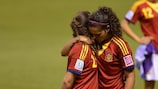 Spain players comfort each other following their final defeat against Japan