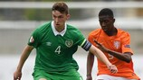 Ireland defender Conor Masterson shields possession from Nigel Robertha