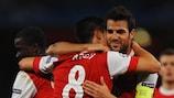Arsenal celebrate Cesc Fàbregas's penalty conversion against Shakhtar