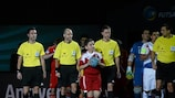 Mark Birkett (second right) and his fellow officials lead out Russia and the Netherlands for the opening game