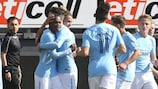 Manchester City celebrate one of their two goals against Feyenoord