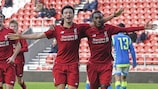 Liverpool celebrate scoring in their decisive win against Napoli