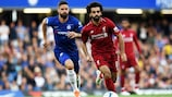 LONDON, ENGLAND - SEPTEMBER 29: Mohamed Salah of Liverpool runs with the ball away from Olivier Giroud of Chelsea during the Premier League match between Chelsea FC and Liverpool FC at Stamford Bridge on September 29, 2018 in London, United Kingdom. (Photo by Shaun Botterill/Getty Images)