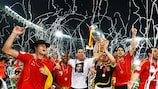 The joyous Spanish players parade the trophy