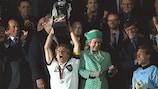 Germany captain Jürgen Klinsmann holds aloft the trophy at EURO '96