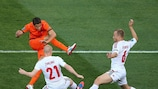 Lars Jacobsen (right) tries to block a shot against the Netherlands