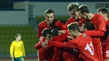 Moldova celebrate a goal against Lithuania