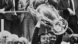 Franz Beckenbauer lifts the trophy after Bayern's second European triumph in 1975