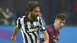Andrea Pirlo shields the ball from Lionel Messi in the UEFA Champions League final