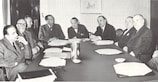 UEFA's first President Ebbe Schwartz (centre) and the European Champion Clubs' Cup organising committee at a meeting soon after the competition's birth