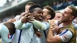 Daniel Sturridge is mobbed after scoring England's winner against Wales