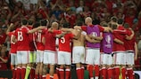 Wales celebrate their qualification as Group B winners following the victory against Russia